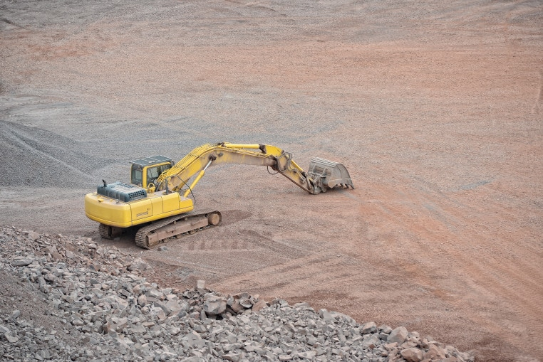earth-mover-in-a-porphyry-rock-quarry-mining-industry-quarry_t20_x6AwzQ